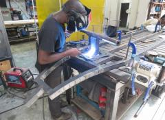 Welding behind a welding screen, in a metal only area with eye protection