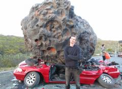 Fabricated meteorite, and crushed car. Fabrication and smoke, Cape Town