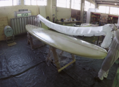 Surf simulating rig, with custom made large scale surf board and chair